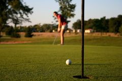 Woman on golf course royalty free stock photos