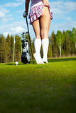 Woman on golf course, back view Royalty Free Stock Photo