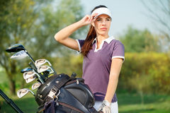 Woman with golf equipment. Beautiful woman golfer ready to play golf Royalty Free Stock Photos