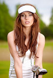 Woman with golf equpment. Young brunette woman and golf Royalty Free Stock Photography