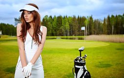 Woman with golf equpment. Young brunette woman and golf Stock Photo
