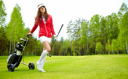 Woman with golf equpment. Young brunette woman and golf Royalty Free Stock Photo
