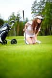 Woman with golf equpment. Young brunette woman and golf Royalty Free Stock Images