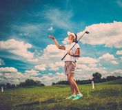 Woman on a golf field Royalty Free Stock Photos