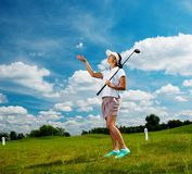 Woman on a golf field Stock Image