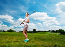 Woman on a golf field Stock Photos