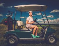 Woman on a golf field Royalty Free Stock Images