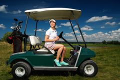 Woman on a golf field Royalty Free Stock Photography