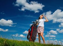 Woman on a golf field Stock Photo