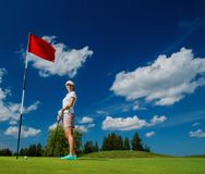 Woman on a golf field Stock Images