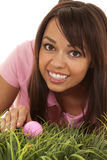 Woman golf pink shirt grass grab Royalty Free Stock Images
