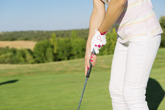 Woman golf player concentrating. Woman golf player concentrating for putting on green. Golf Concept Royalty Free Stock Photo