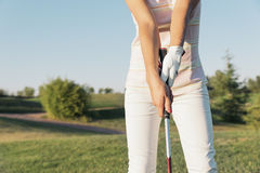 Woman golf player concentrating. Woman golf player concentrating for putting on green. Golf Concept Stock Image