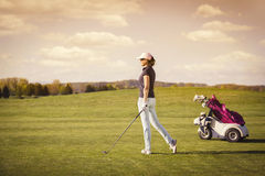 Woman golf player with copyspace. Royalty Free Stock Photography