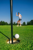 Woman golf player. On the green grass Royalty Free Stock Photo