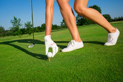 Woman golf player. On the green grass Royalty Free Stock Image