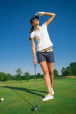 Woman golf player. On the green grass Stock Images