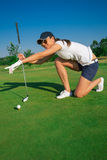 Woman golf player Royalty Free Stock Image