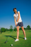 Woman golf player. On the green grass Royalty Free Stock Images