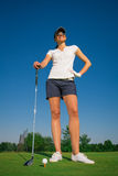 Woman golf player. On the green grass Royalty Free Stock Photography