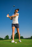 Woman golf player. On the green grass Stock Image