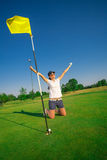 Woman golf player. On the green grass Stock Photo