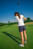 Woman golf player. On the green grass Royalty Free Stock Photos