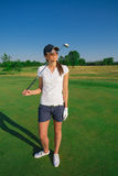 Woman golf player. On the green grass Stock Photos