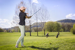 Woman golf player pitching. Stock Images