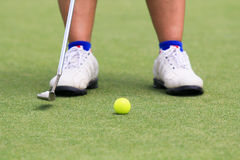 Woman golf player putting on the green Royalty Free Stock Photos