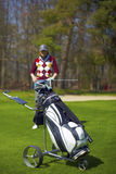 Woman at the golf range with trolley bag. Woman at the golf range with golf trolley bag Royalty Free Stock Photo