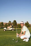 Woman Golfer. A pretty woman golfer ready to hit on the fairway Royalty Free Stock Images