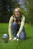 Woman golfer aiming with iron Royalty Free Stock Photos
