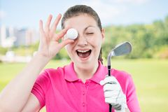 Woman golfer funny portrait. On a background of golf courses Stock Photos