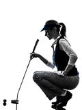 Woman golfer golfing silhouette Royalty Free Stock Photos
