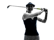 Woman golfer golfing silhouette. In white background royalty free stock photos