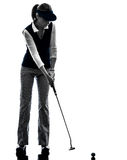 Woman golfer golfing silhouette Royalty Free Stock Images