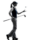 Woman golfer golfing silhouette. In white background royalty free stock photography