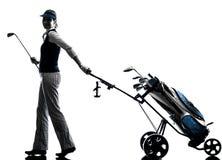 Woman golfer golfing silhouette Stock Photos