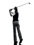 Woman golfer golfing silhouette. In white background stock photos