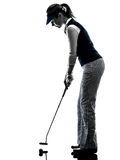 Woman golfer golfing silhouette. In white background royalty free stock image
