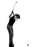 Woman golfer golfing silhouette. In white background royalty free stock images