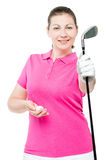 Woman golfer holding a stick and a ball on a white Stock Photos