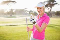 Woman golfer looking her mobile phone royalty free stock photos