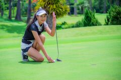 Free Woman Golfer Playing Golf On The Field Stock Photo - 186827290
