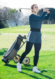 Woman golfer propelled ball successfully at golf course Stock Photo