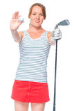 Woman golfer showing a ball and a golf club. Props in focus Royalty Free Stock Photos