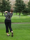 Woman golfer swing