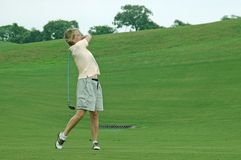 Free Woman Golfer Taking The Shot Royalty Free Stock Photography - 842787