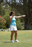 Woman Golfing. Woman pointing to where her golf ball went after hitting it on the fairway Stock Image